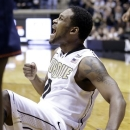 Purdue guard Terone Johnson celebrates after hitting a shot and being fouled by Illinois late in the second half of an NCAA college basketball game in West Lafayette, Ind., Wednesday, Jan. 2, 2013. Purdue won 68-61. (AP Photo/Michael Conroy)