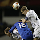Tottenham's Michael Dawson, right, competes for the ball with Dnipro's Roman Zozulya, center, during the Europa League Group K soccer match between Tottenham Hotspur and Dnipro at White Hart Lane stadium in London, Thursday, Feb. 27, 2014