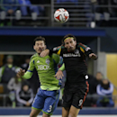 Los Angeles Galaxy's Alan Gordon (9) and Seattle Sounders midfielder Brad Evans battle for a header during the second leg of the MLS soccer western conference final, Sunday, Nov. 30, 2014, in Seattle The Associated Press