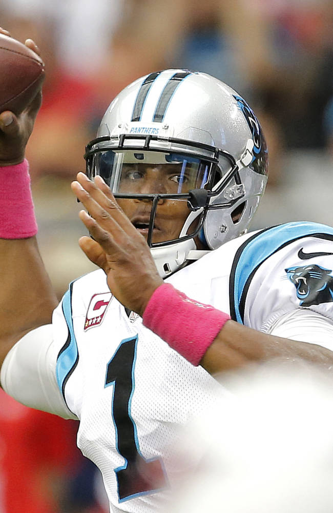 Carolina Panthers quarterback Cam Newton (1) throws against the Arizona Cardinals during the first half of an NFL football game, Sunday, Oct. 6, 2013, in Glendale, Ariz