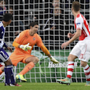 Anderlecht's Andy Najar his header go past Arsenal's goalkeeper Emiliano Martinez, center, as he scores 1-0 during the Group D Champions League match between Anderlecht and Arsenal at Constant Vanden Stock Stadium in Brussels, Belgium, Wednesday Oct. 22,