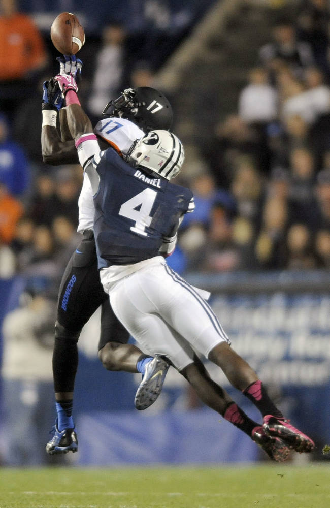 Boise State Broncos wide receiver Geraldo Boldewijn (17) is unable to make a catch as Brigham Young Cougars defensive back Robertson Daniel (4) defends during a game at Lavell Edwards Stadium on Friday,  Oct. 25, 2013, in Provo, Utah