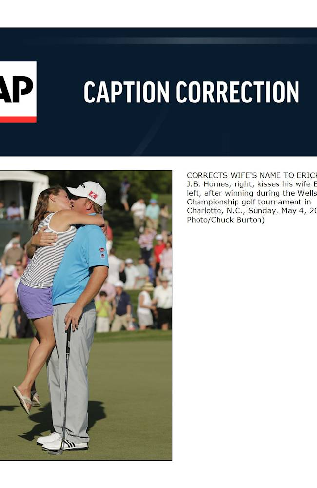 CORRECTS WIFE'S NAME TO ERICKA  - J.B. Homes, right, kisses his wife Ericka, left, after winning during the Wells Fargo Championship golf tournament in Charlotte, N.C., Sunday, May 4, 2014