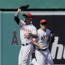 Los Angeles Angels right fielder Josh Hamilton (32) catches a fly off the Chicago White Sox' Alexei Ramirez as center fielder Mike Trout backstops, for the final out of baseball game in Anaheim, Calif., Sunday, May 19, 2013. The Angels won, 6-2. (AP Photo/Reed Saxon)