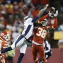 Kansas City Chiefs strong safety Ron Parker (38) breaks up a pass intended for Denver Broncos wide receiver Emmanuel Sanders in the second half of an NFL football game in Kansas City, Mo., Sunday, Nov. 30, 2014 The Associated Press