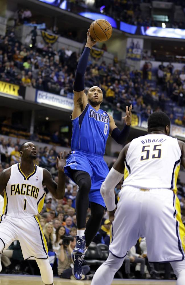 Dallas Mavericks forward Shawn Marion, center, shoots between Indiana Pacers guard Lance Stephenson (1) and center Roy Hibbert (55) during the first half of an NBA basketball game in Indianapolis, Wednesday, Feb. 12, 2014