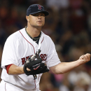 Boston Red Sox starting pitcher Jon Lester reacts after an out made by the Detroit Tigers during the seventh inning of a baseball game at Fenway Park in Boston, Tuesday, Sept. 3, 2013. (AP Photo/Elise Amendola)