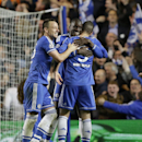 Chelaea's John Terry, left, Demba Ba, centre, and Fernando Torres celebrate winning the Champions League second leg quarterfinal soccer match between Chelsea and Paris Saint-Germain at Stamford Bridge Stadium in London, Tuesday, April 8, 2014