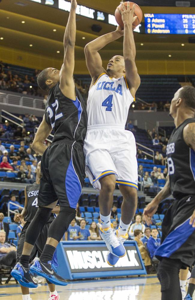 UCLA's Norman Powell (4) shoots against Cal State San Bernardino's Joshua Gouch (22) in the second half of an NCAA college exhibition  basketball game on Wednesday, Oct. 30, 2013, in Los Angeles