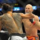 Jan 18, 2015; Boston, MA, USA; Donald Cerrone (red) and Benson Henderson (blue) compete during a lightweight bout at UFC Fight Night at TD Garden. (Bob DeChiara-USA TODAY Sports)