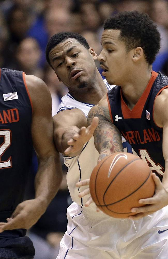 Duke's Quinn Cook, center, reaches for the ball as Maryland's Seth Allen (4) passes to Dez Wells (32) during the first half of an NCAA college basketball game in Durham, N.C., Saturday, Feb. 15, 2014
