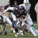 Miami Dolphins safety Louis Delmas, right, tackles Chicago Bears quarterback Jay Cutler (6) during the first half of an NFL football game Sunday, Oct. 19, 2014 in Chicago The Associated Press