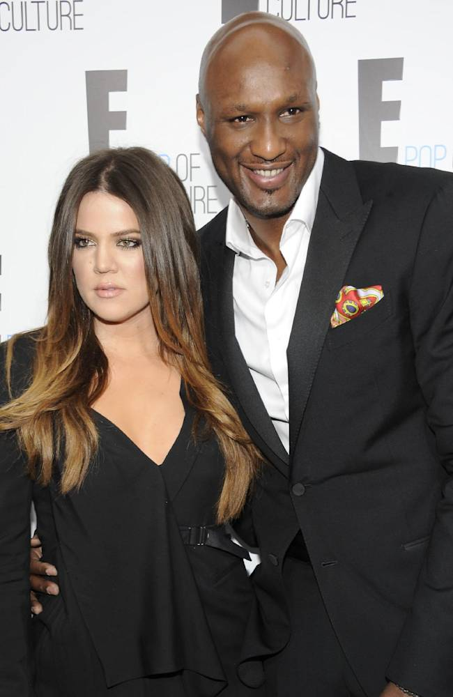 In this April 30, 2012 file photo, Khloe Kardashian Odom and Lamar Odom pose at an E! Network event in New York. Odom is breaking his silence with his first post on Twitter since the NBA star was arrested and charged with driving under the influence last month. Odom tweeted