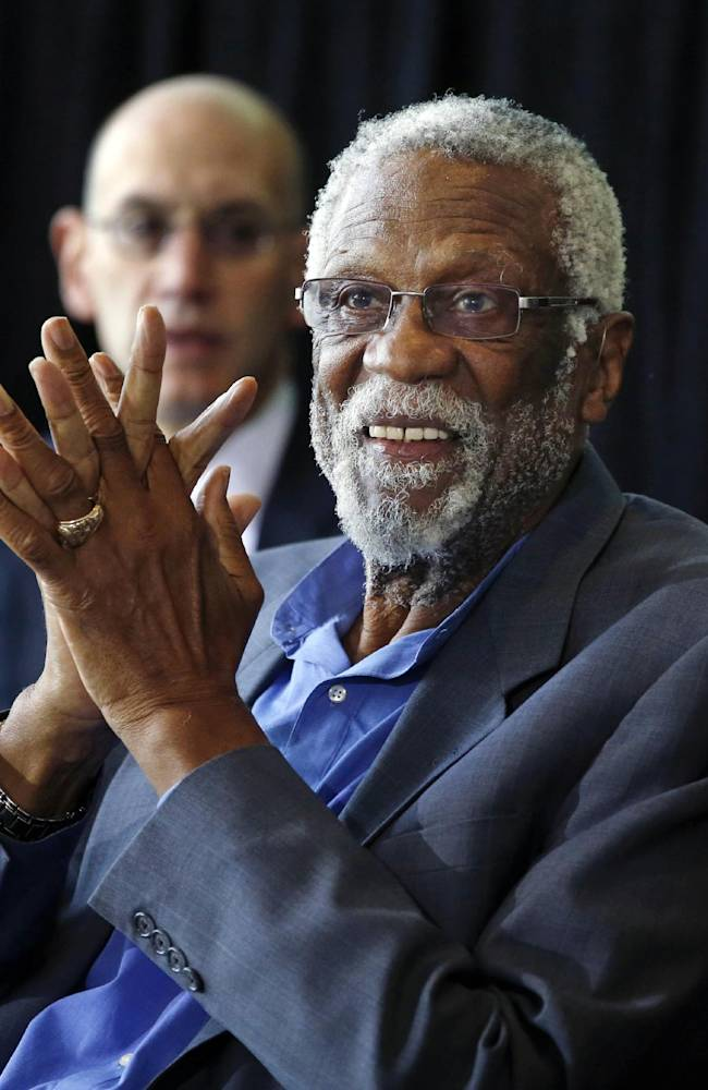 Former Boston Celtics basketball player Bill Russell applauds during a ceremony honoring him after a statue was unveiled at City Hall Plaza in Boston, Friday, Nov. 1, 2013