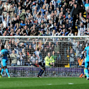 West Brom's fans celebrate as goalkeeper Ben Foster, below right, saves a penalty from Tottenham's Emmanuel Adebayor, thrid left, during the English Premier League soccer match between West Bromwich Albion and Tottenham Hotspur at The Hawthorns Stadium in