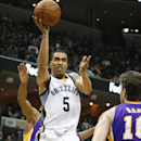 Memphis Grizzlies forward Courtney Lee (5) shoots over Los Angeles Lakers forward Pau Gasol (16) of Spain, in the second half of an NBA basketball game, Wednesday, Feb. 26, 2014, in Memphis, Tenn. The Grizzlies won 108-103 The Associated Press