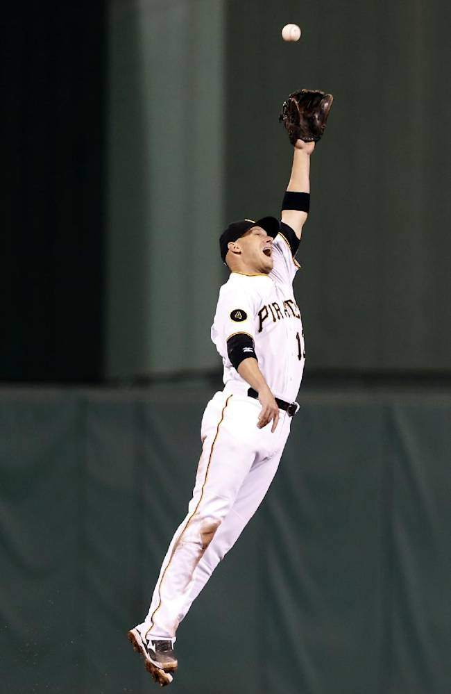 Pittsburgh Pirates shortstop Clint Barmes leaps for a drive hit by Milwaukee Brewers' Jean Segura that went for a double in the ninth inning of the baseball game on Saturday, April 19, 2014, in Pittsburgh. Barmes did not catch the ball and the Brewers won 8-7