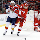 Florida Panthers right wing Brad Boyes (24) and Detroit Red Wings left wing Henrik Zetterberg (40) battle for position in the first period during an NHL hockey game in Detroit Tuesday, Dec. 2, 2014 The Associated Press