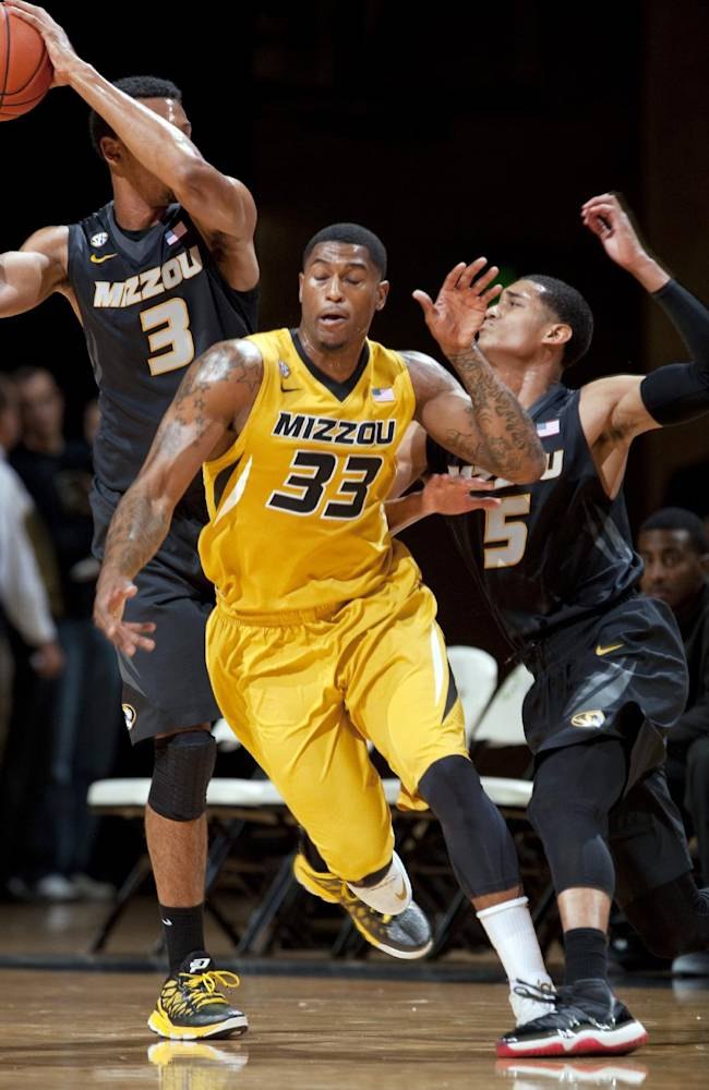 Missouri's Johnathan Williams, III, left, pulls the ball away from Earnest Ross, center, with Jordan Clarkson at right during an NCAA college basketball scrimmage Tuesday, Oct. 15, 2013, in Columbia, Mo