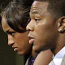 In this May 23, 2014, file photo, Janay Rice, left, looks on as her husband, Baltimore Ravens running back Ray Rice, speaks to the media during an news conference in Owings Mills, Md. Rice starts his two-game suspension Saturday, Aug. 30, 2014, missing th