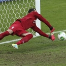 Brazil goalkeeper Julio Cesar saves a penalty during the soccer Confederations Cup semifinal match between Brazil and Uruguay at the Mineirao stadium in Belo Horizonte, Brazil, Wednesday, June 26, 2013. (AP Photo/Andre Penner)