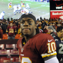 Washington Redskins quarterback Robert Griffin III looks back across the field after an NFL wild card playoff football game against the Seattle Seahawks in Landover, Md., Sunday, Jan. 6, 2013. The Seahawks defeated the Redskins 24-14. (AP Photo/Richard Lipski)