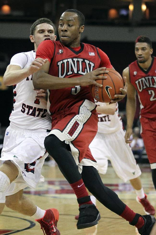UNLV's Kevin Olekaibe, right, drives on Fresno State's Tyler Johnson in the first half of an NCAA college basketball game in Fresno, Calif., Wednesday, Jan. 1, 2014