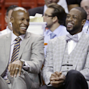 Miami Heat guards Ray Allen, left, and Dwyane Wade laugh as they sit on the bench during the first half of an NBA basketball game against the Milwaukee Bucks, Wednesday, April 2, 2014, in Miami The Associated Press