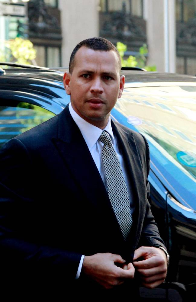 FILE- In this Oct. 1, 2013, file photo, New York Yankees' Alex Rodriguez arrives at the offices of Major League Baseball for grievance hearing in New York. Rodriguez allegeldy paid $305,000 for evidence that could be used in the case involving the Biogenesis of America drug clinic, the Daily News reported Saturday, Oct. 19, 2013. The allegation was denied by a spokesman for the Yankees' third baseman. Rodriguez was suspended Aug. 5 but was allowed to keep playing pending a decision on the grievance