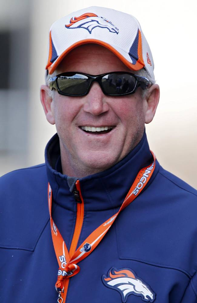 Denver Broncos head coach John Fox smiles as he talks to the media during practice for the football team's NFL playoff game against the San Diego Chargers at the Broncos training facility in Englewood, Colo., Friday, Jan. 10, 2014