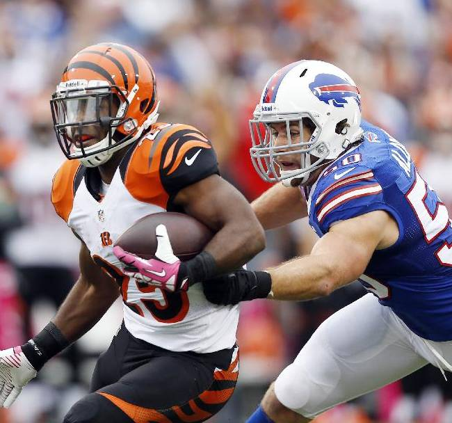 In this Oct. 13, 2013, file photo, Cincinnati Bengals' Giovani Bernard (25) runs downfield as Buffalo Bills' Kiko Alonso closes in during the second half of an NFL football game in Orchard Park, N.Y. General manager Doug Whaley announced that Alonso had been hurt with what the team fears to be a serious knee injury while working out in Oregon released in a statement by the team Tuesday, July 1, 2014