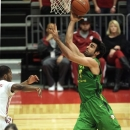 Oregon forward Arsalan Kazemi, right, shoots as Washington State guard Royce Woolridge, left, watches during the first half of an NCAA college basketball game on Saturday, Feb. 16, 2013, at Beasely Coliseum in Pullman, Wash. (AP Photo/Dean Hare)