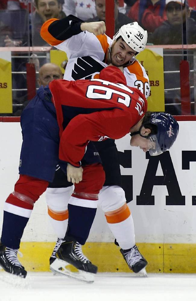 Philadelphia Flyers center Zac Rinaldo (36) fights with Washington Capitals center Michael Latta during the second period of an NHL hockey game, Sunday, Dec. 15, 2013, in Washington