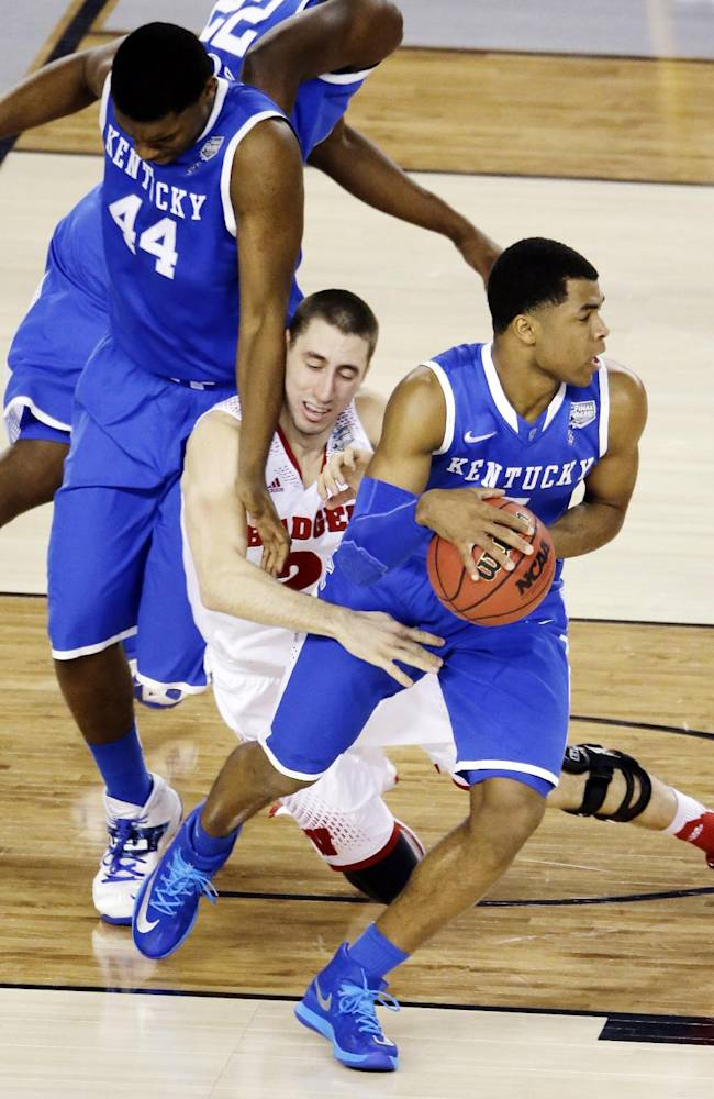 Kentucky guard Aaron Harrison (2) takes the ball from Wisconsin guard Josh Gasser (21) as center Dakari Johnson (44) defends during the first half of the NCAA Final Four tournament college basketball semifinal game Saturday, April 5, 2014, in Arlington, Texas