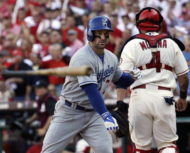 Los Angeles Dodgers' Nick Punto throws his bat in front of St. Louis Cardinals catcher Yadier Molina after striking out during the fifth inning of Game 2 of the National League baseball championship series Saturday, Oct. 12, 2013, in St. Louis