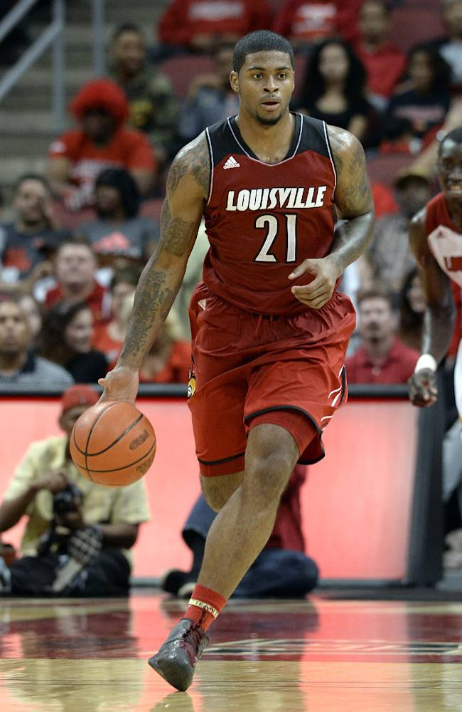 Louisville's Chane Behanan brings the ball upcourt during action of their NCAA mens college basketball scrimmage Saturday, Oct. 5, 2013, in Louisville, Ky