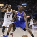 Philadelphia 76ers' Damien Wilkins (8) drives past Cleveland Cavaliers' Wayne Ellington (21) during the first quarter of an NBA basketball game Friday, March 29, 2013, in Cleveland. (AP Photo/Tony Dejak)