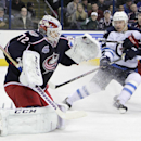 Columbus Blue Jackets' Sergei Bobrovsky, left, of Russia, makes a save as teammate Matt Calvert, right, and Winnipeg Jets' Bryan Little fight for position during the first period of an NHL hockey game Tuesday, Nov. 25, 2014, in Columbus, Ohio The Associat