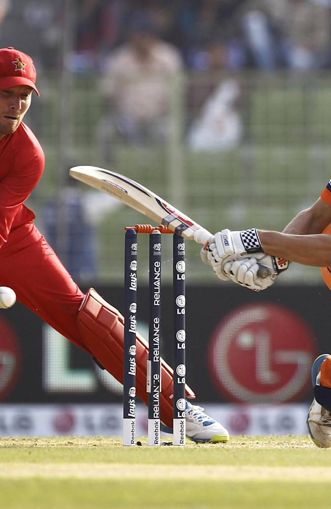 Netherlands' Ben Cooper, right, plays a shot in front of Zimbabwe's captain Brendan Taylor during their ICC Twenty20 Cricket World Cup match in Sylhet, Bangladesh, Wednesday, March 19, 2014
