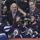 Winnipeg Jets coach Paul Maurice talks to Olli Jokinen (12) during a break in the second period of an NHL hockey game against the Pittsburgh Penguins in Winnipeg, Manitoba, on Thursday, April 3, 2014 The Associated Press