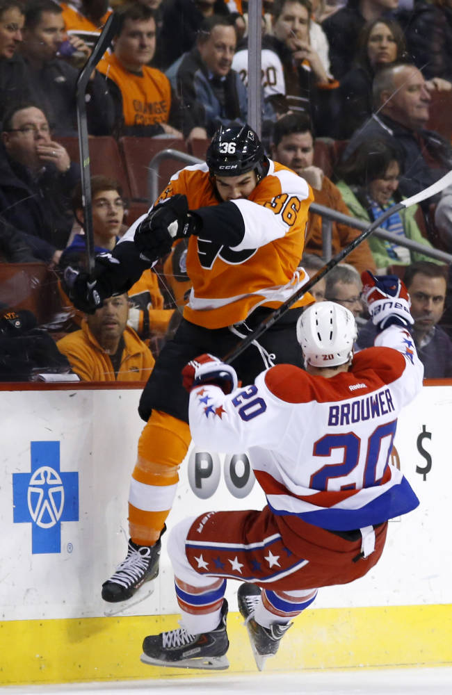 Philadelphia Flyers' Zac Rinaldo, left, collides with Washington Capitals' Troy Brouwer during the first period of an NHL hockey game, Wednesday, March 5, 2014, in Philadelphia