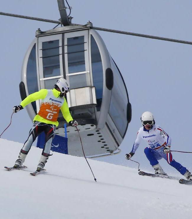 Ivan Frantsev of Russia, right, and his guide German Agranovsky race during the men's downhill, visually impaired event at the 2014 Winter Paralympic, Saturday, March 8, 2014, in Krasnaya Polyana, Russia