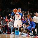 NEW YORK, NY - NOVEMBER 22: Carmelo Anthony #7 of the New York Knicks defends the ball against Robert Covington # 33 of the Philadelphia 76ers during the game on November 22, 2014 at Madison Square Garden in New York, New York. (Photo by Nathaniel S. Butler/NBAE via Getty Images)