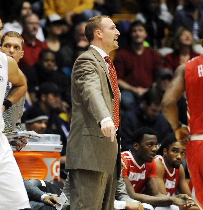 Illinois State head coach Dan Muller, center, directs his team during the first half of an NCAA college basketball game against Northwestern in Evanston, Ill., on Sunday, Nov. 17, 2013