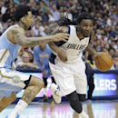 Dallas Mavericks forward Jae Crowder (9) drives against Denver Nuggets forward Wilson Chandler (21) during the first half an NBA basketball game Friday, March 21, 2014, in Dallas The Associated Press