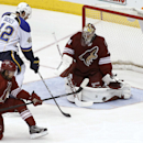 Phoenix Coyotes goaltender Mike Smith (41) makes a pad save in front of St Louis Blues' David Backes (42) as Coyotes' David Schlemko (6) looks to clear the puck during the second period of an NHL hockey game on Sunday, March 2, 2014, in Glendale, Ariz The