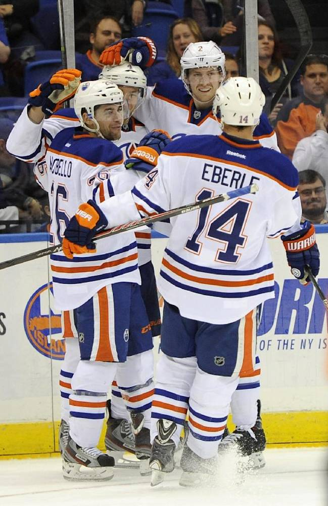 Edmonton Oilers' Taylor Hall (4), Mark Arcobello (26), Jeff Petry (2) and Jordan Eberle (14) celebrate Hall's second goal  in the first period of an NHL hockey game on Thursday, Oct. 17, 2013, in Uniondale, N.Y