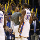 Oklahoma City Thunder guard Russell Westbrook (0) chest-bumps teammate Kevin Durant (35) during a timeout in the fourth quarter of an NBA basketball game against the Houston Rockets in Oklahoma City, Tuesday, March 11, 2014. Oklahoma City won 106-98. (AP Photo/Sue Ogrocki)
