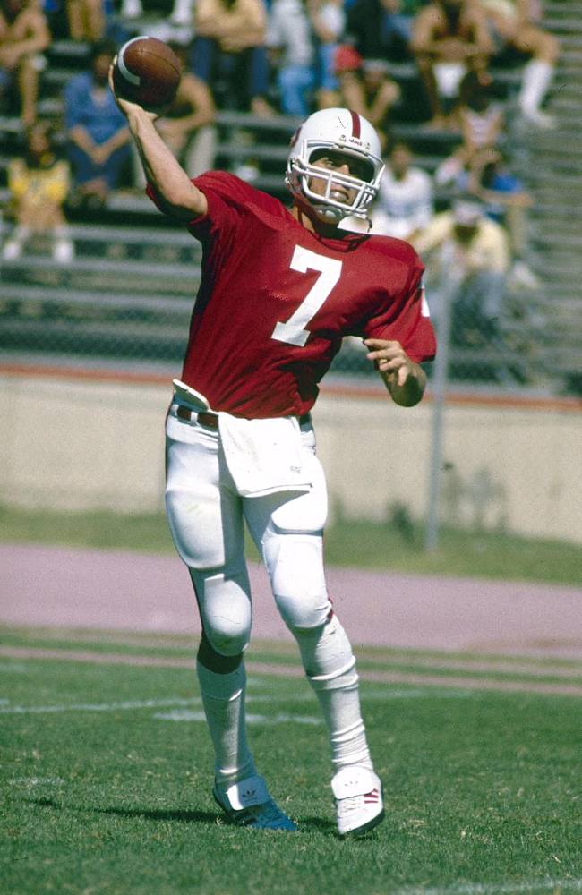 In this 1981 file photo, Stanford quarterback John Elway passes during an NCAA college football game in Stanford, Calif.  Thirty years after Elway left school, Stanford is finally retiring his No. 7 jersey. The former Cardinal quarterback and No. 1 overall pick of the 1983 NFL draft will have his jersey retired during halftime of sixth-ranked Stanford's home game against No. 2 Oregon on Thursday night, Nov. 7. He'll join Jim Plunkett (No. 16) and Ernie Nevers (No. 1) as the only players whose jerseys have been enshrined by the program