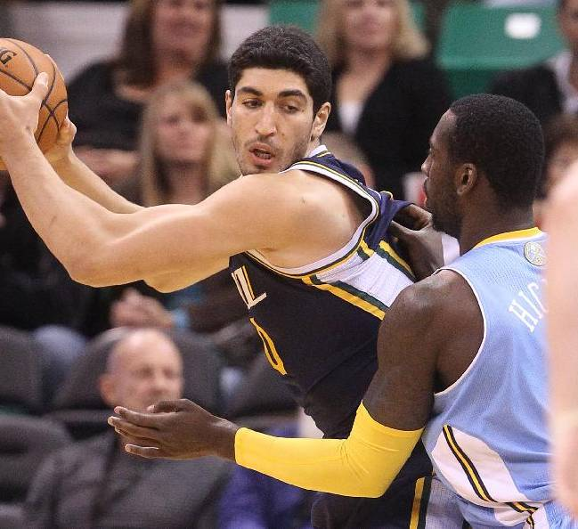Denver Nuggets' J.J. Hickson, right, defends against Utah Jazz's Enes Kanter, left, of Turkey, in the first quarter during an NBA basketball game Monday, Nov. 11, 2013, in Salt Lake City